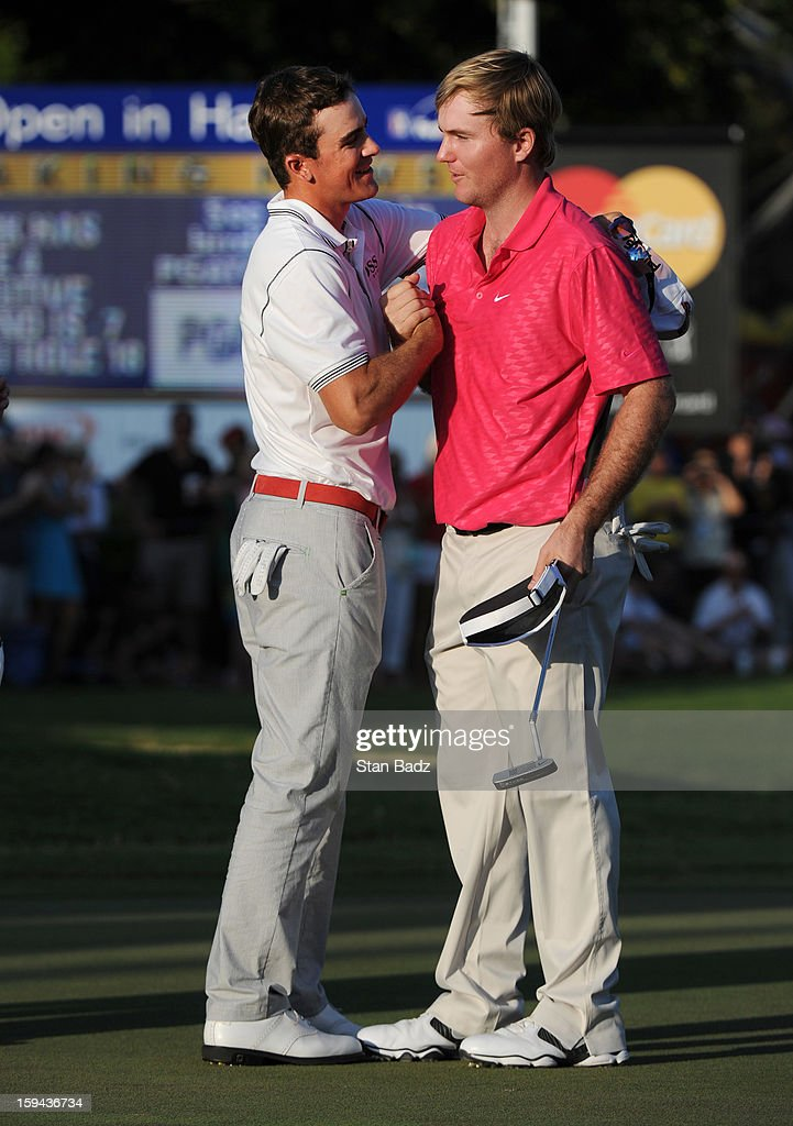 Scott Langley congratulates Russell Henley on winning the Sony Open in the final round of the Sony Open in Hawaii at Waialae Country Club on January 13, 2013 in Honolulu, Hawaii.