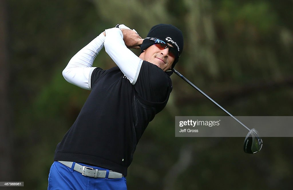 Scott Langley hits a tee shot during the third round of the ATT Pebble Beach National ProAm at the Spyglass Hill Golf Course on February 8 2014 in...