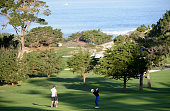 Scott Langley hits his second shot on the fisrt hole during the first round of the ATT Pebble Beach National ProAm at Spyglass Hill on February 12...