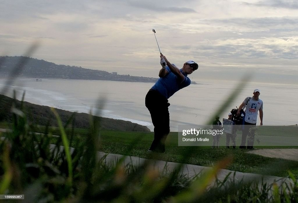 <a gi-track='captionPersonalityLinkClicked' href=/galleries/search?phrase=Scott+Langley&family=editorial&specificpeople=4459429 ng-click='$event.stopPropagation()'>Scott Langley</a> hits off the rough during the first round at the Farmers Insurance Open at Torrey Pines Golf Course on January 24, 2013 in La Jolla, California.