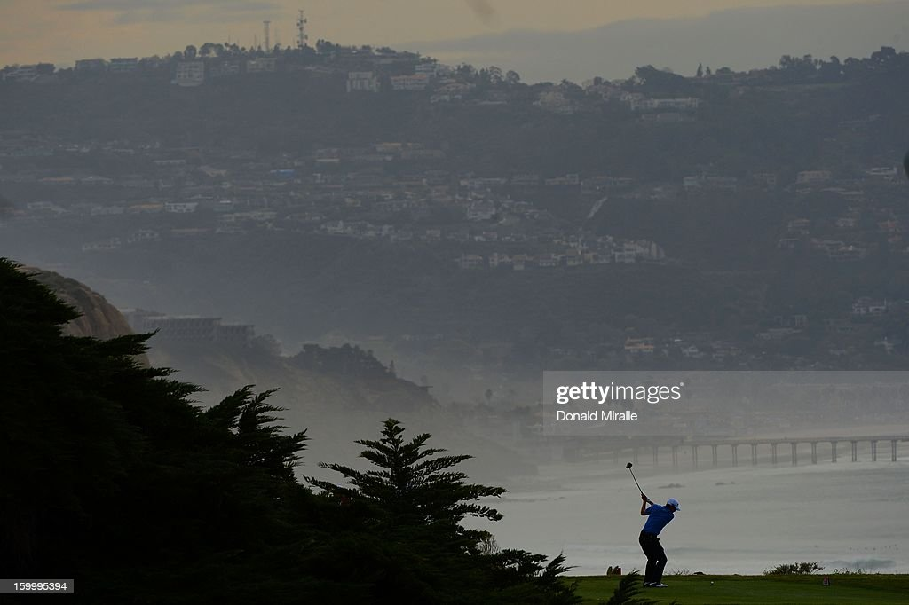 <a gi-track='captionPersonalityLinkClicked' href=/galleries/search?phrase=Scott+Langley&family=editorial&specificpeople=4459429 ng-click='$event.stopPropagation()'>Scott Langley</a> hits off the tee box during the first round at the Farmers Insurance Open at Torrey Pines Golf Course on January 24, 2013 in La Jolla, California.
