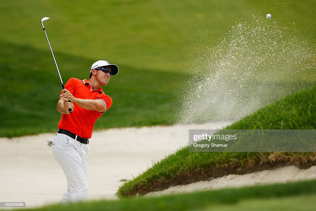 Scott Langley hits out of a bunker on the ninth hole during the second round of the John Deere Classic Round Two held at TPC Deere Run on July 11...