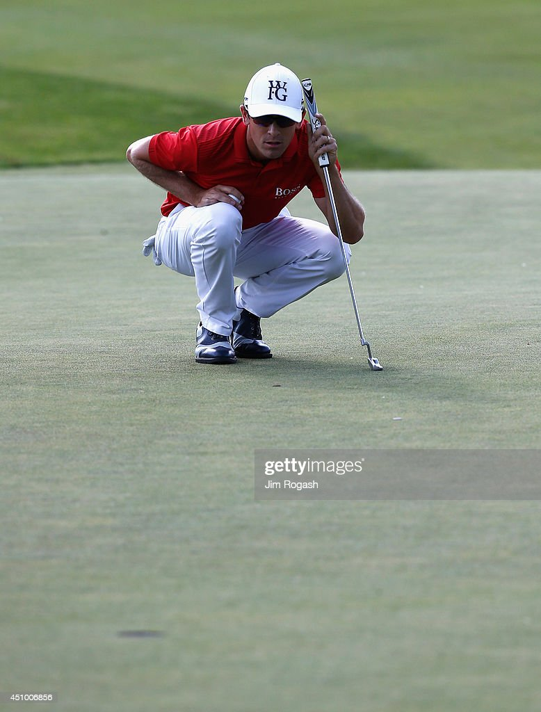 Scott Langley of the United States lines up his putt on the 17th hole during the third round of the Travelers Championship golf tournament at the TPC...