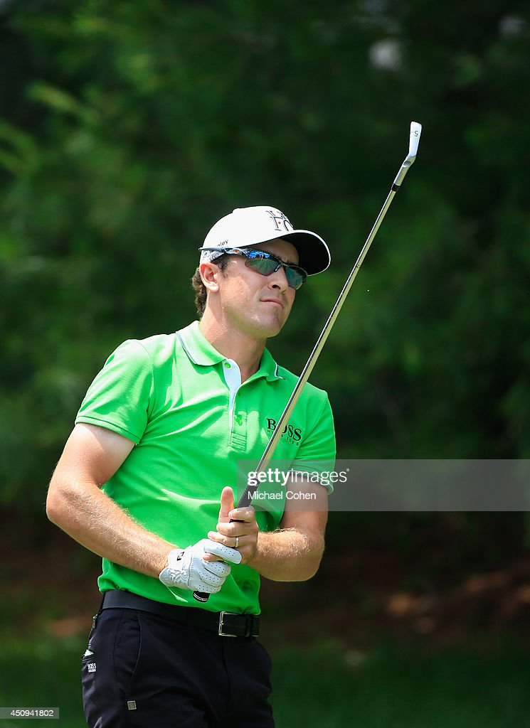 Scott Langley of the United States watches his tee shot on the eighth hole during the second round of the Travelers Championship golf tournament at...
