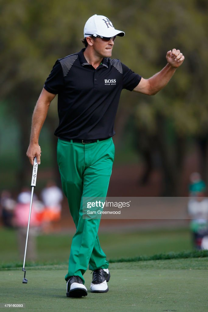 Scott Langley reacts on the 18th green during the final round of the Valspar Championship at Innisbrook Resort and Golf Club on March 16 2014 in Palm...
