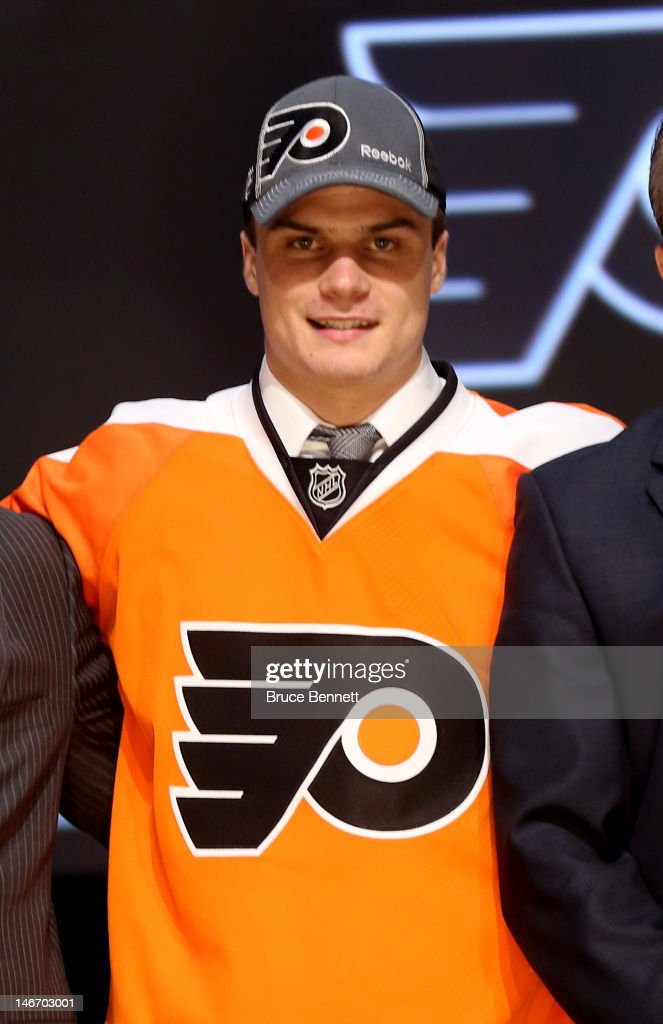 Scott Laughton, 20th pick overall by the Philadelphia Flyers, poses on stage during Round One of the 2012 NHL Entry Draft at Consol Energy Center on June 22, 2012 in Pittsburgh, Pennsylvania.
