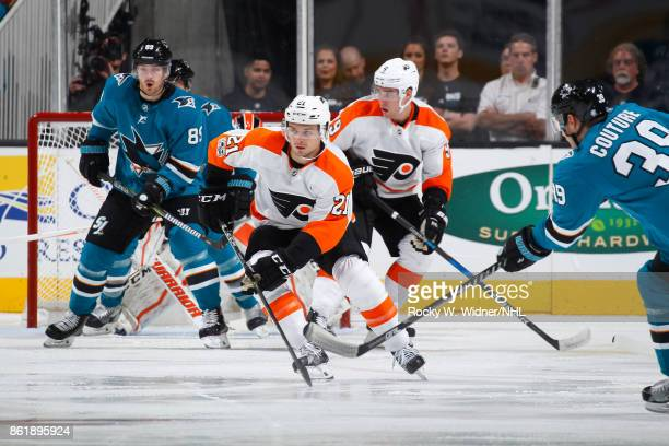 Scott Laughton and Ivan Provorov of the Philadelphia Flyers defend Logan Couture and Mikkel Boedker of the San Jose Sharks at SAP Center at San Jose...