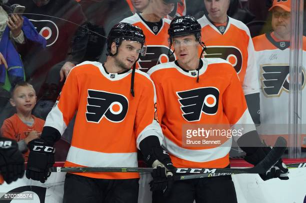 Scott Laughton and Jori Lehtera of the Philadelphia Flyers skate in warmups prior to the game against the Colorado Avalanche at the Wells Fargo...