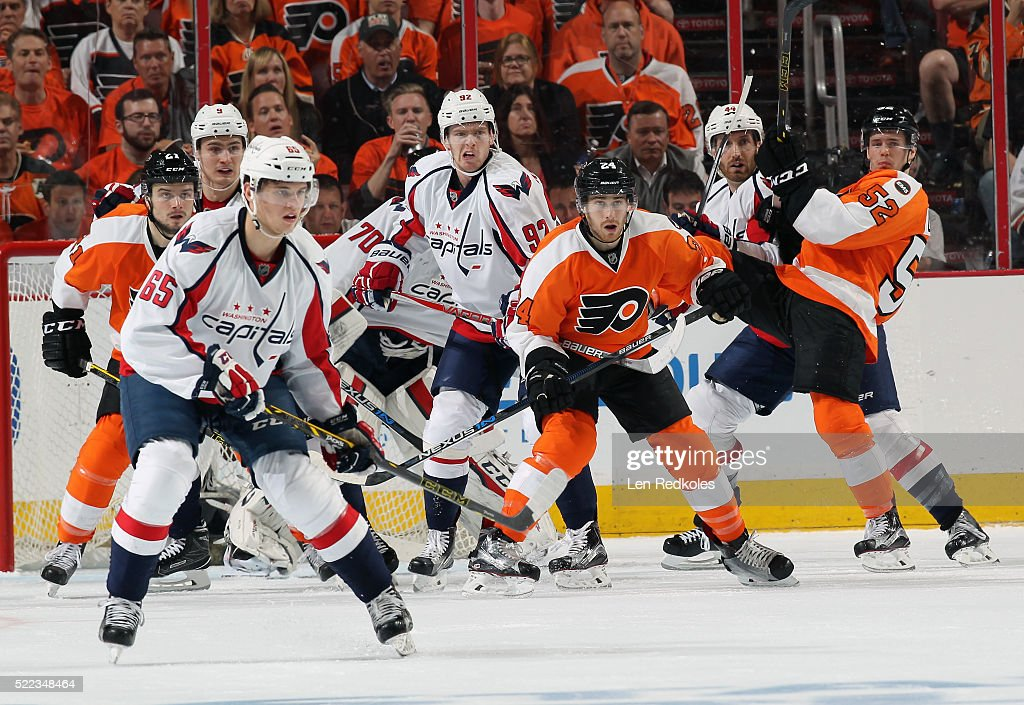 Scott Laughton Matt Read and Nick Cousins of the Philadelphia Flyers battle in front of goaltender Braden Holtby of the Washington Capitals with...