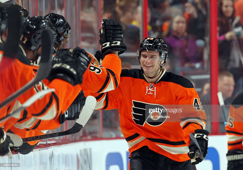 <a gi-track='captionPersonalityLinkClicked' href=/galleries/search?phrase=Scott+Laughton&family=editorial&specificpeople=8050728 ng-click='$event.stopPropagation()'>Scott Laughton</a> #49 of the Philadelphia Flyers celebrates his second period goal against the Carolina Hurricanes on December 13, 2014 at the Wells Fargo Center in Philadelphia, Pennsylvania. The goal was Laughton's first of his NHL career.