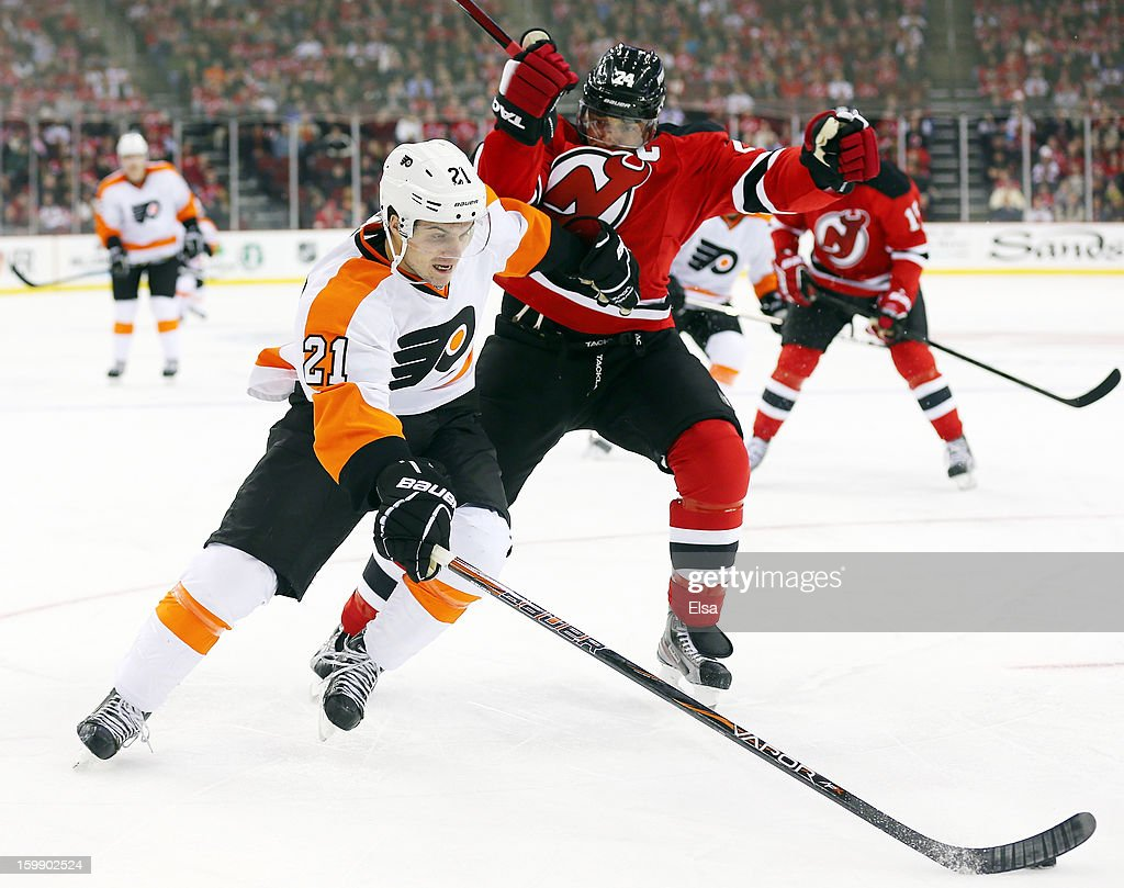 <a gi-track='captionPersonalityLinkClicked' href=/galleries/search?phrase=Scott+Laughton&family=editorial&specificpeople=8050728 ng-click='$event.stopPropagation()'>Scott Laughton</a> #21 of the Philadelphia Flyers heads for the net as <a gi-track='captionPersonalityLinkClicked' href=/galleries/search?phrase=Bryce+Salvador&family=editorial&specificpeople=208746 ng-click='$event.stopPropagation()'>Bryce Salvador</a> #24 of the New Jersey Devils defends during the season opener at the Prudential Center on January 22, 2013 in Newark, New Jersey.The New Jersey Devils shut out the Philadelphia Flyers 3-0.
