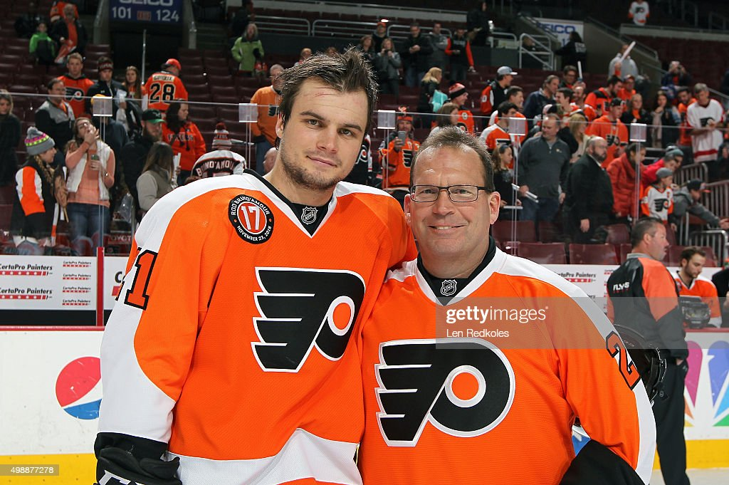 <a gi-track='captionPersonalityLinkClicked' href=/galleries/search?phrase=Scott+Laughton&family=editorial&specificpeople=8050728 ng-click='$event.stopPropagation()'>Scott Laughton</a> #21 of the Philadelphia Flyers poses with his father Craig after defeating the Carolina Hurricanes 3-2 in overtime on November 23, 2015 at the Wells Fargo Center in Philadelphia, Pennsylvania.