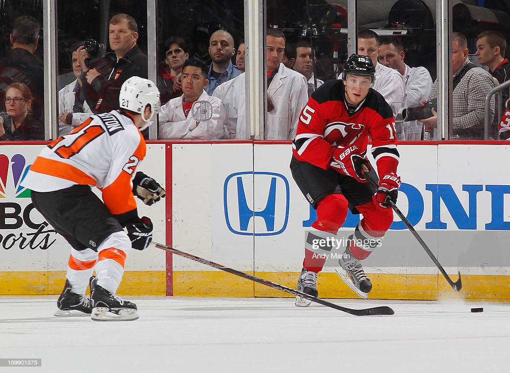 Scott Laughton #21 of the Philadelphia Flyers pursues Stefan Matteau #15 of the New Jersey Devils as he plays the puck during the Devils' home opener at the Prudential Center on January 22, 2013 in Newark, New Jersey. The Devils shutout the Flyers 3-0.