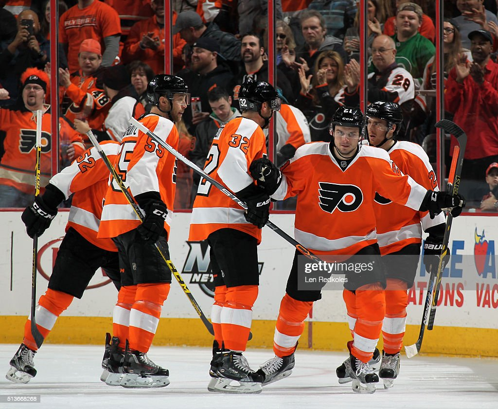 <a gi-track='captionPersonalityLinkClicked' href=/galleries/search?phrase=Scott+Laughton&family=editorial&specificpeople=8050728 ng-click='$event.stopPropagation()'>Scott Laughton</a> #21 of the Philadelphia Flyers reacts with teammates after scoring a first period goal against the Arizona Coyotes on February 27, 2016 at the Wells Fargo Center in Philadelphia, Pennsylvania.