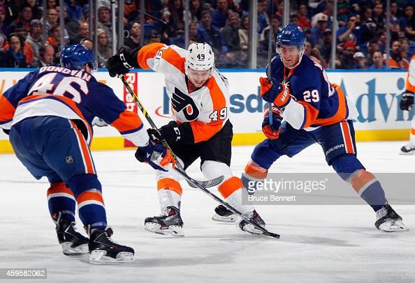 Scott Laughton of the Philadelphia Flyers skates against the New York Islanders at the Nassau Veterans Memorial Coliseum on November 24 2014 in...