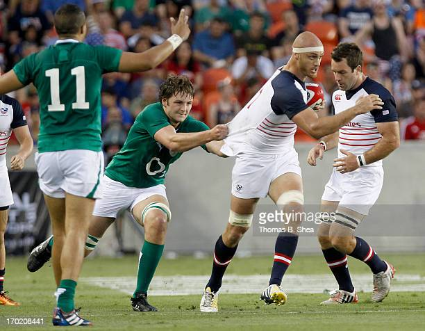 Scott Lavalla of the United States Eagles has his jersey pulled by Devin Toner of the Irish Rugby Football Union in a rugby game in the first half at...
