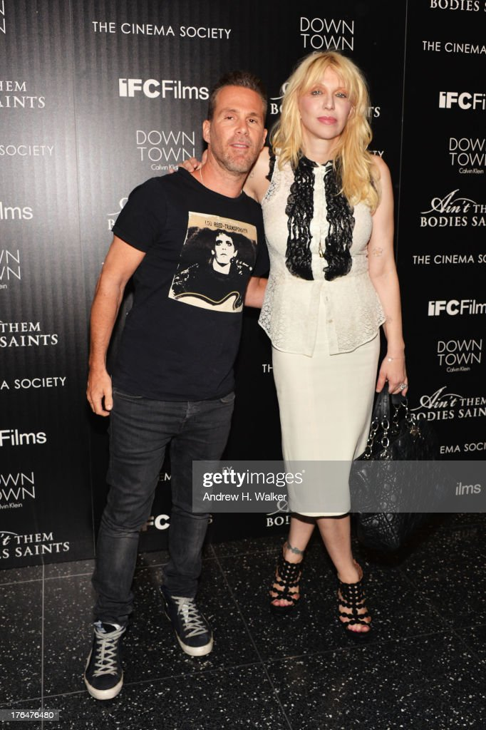 Scott Lipps (L) and Courtney Love attend the Downtown Calvin Klein with The Cinema Society screening of IFC Films' 'Ain't Them Bodies Saints' at the Museum of Modern Art on August 13, 2013 in New York City.