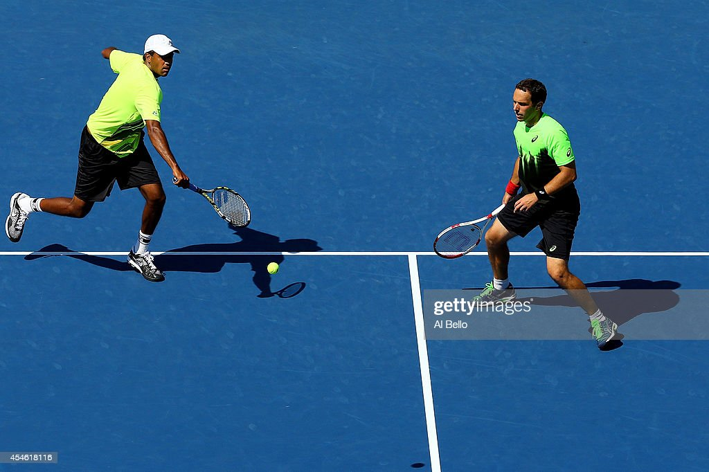Scott Lipsky and Rajeev Ram of the United States play against Bob Bryan and Mike Bryan of the United States during their men's doubles semifinal...