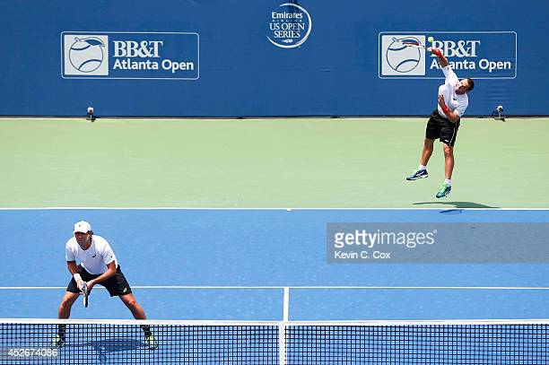 Scott Lipsky and Santiago Gonzalez of Mexico serve to Steve Johnson and Sam Querrey during the BBT Atlanta Open at Atlantic Station on July 25 2014...