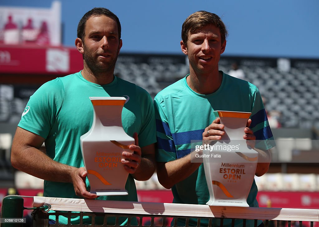 Scott Lipsky from the United States (L) and teammate Eric Butorac from the United States (R) pose for a photo with their trophies after winning the Millennium Estoril Open 2016 at the end of the doubles final match between Lukasz Kubot and Marcin Matkowski from Poland and Eric Butorac and Scott Lipsky from the United States for Millennium Estoril Open at Clube de Tenis do Estoril on May 1, 2016 in Estoril, Portugal.