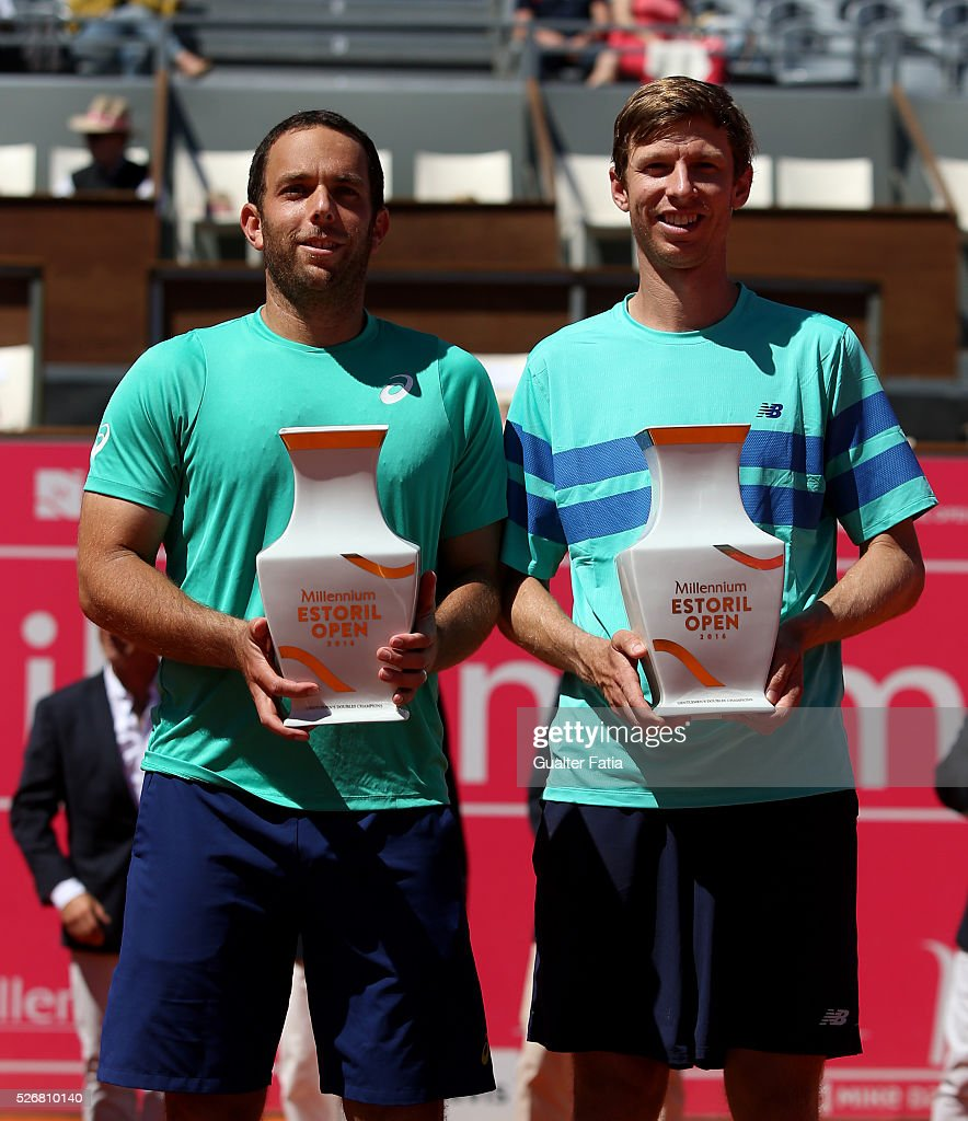 Scott Lipsky from the United States (L) and teammate Eric Butorac from the United States (R) with the trophy after winning the Millennium Estoril Open 2016 at the end of the doubles final match between Lukasz Kubot and Marcin Matkowski from Poland and Eric Butorac and Scott Lipsky from the United States for Millennium Estoril Open at Clube de Tenis do Estoril on May 1, 2016 in Estoril, Portugal.