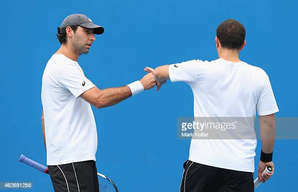 Scott Lipsky of the United States and Santiago Gonzalez of Mexico talk tactics in their first round doubles match against Oliver Marach of Austria...