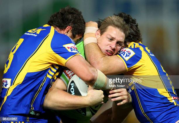 Scott Logan of the Raiders is tackled during the round five NRL match between the Parramatta Eels and the Canberra Raiders at Parramatta Stadium on...