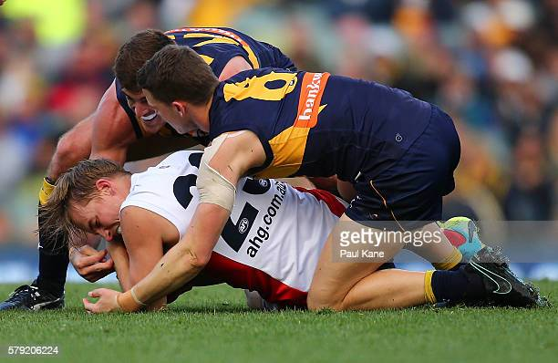 Scott Lycett and Jack Redden of the Eagles tackle Bernie Vince of the Demons during the round 18 AFL match between the West Coast Eagles and the...