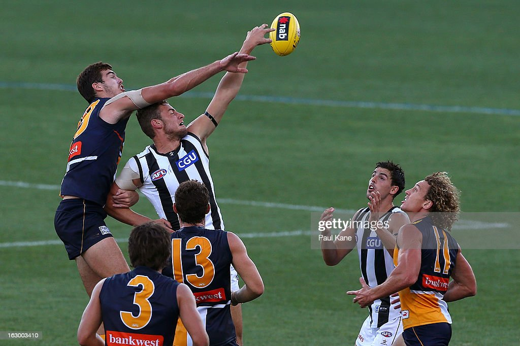 Scott Lycett of the Eagles and Jarrod Witts of the Magpies contest a boundary throw in during the round two AFL NAB Cup match between the West Coast Eagles and the Collingwood Magpies at Patersons Stadium on March 3, 2013 in Perth, Australia.
