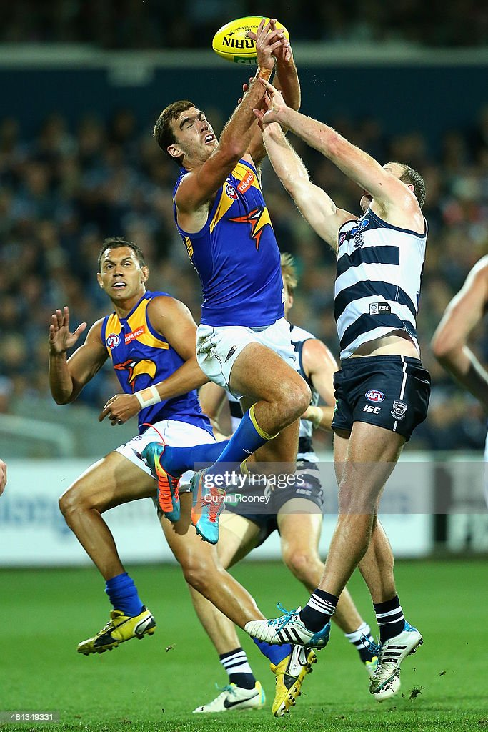 Scott Lycett of the Eagles marks over the top of Steve Johnson of the Cats during the round four AFL match between the Geelong Cats and the West Coast Eagles at Skilled Stadium on April 12, 2014 in Melbourne, Australia.