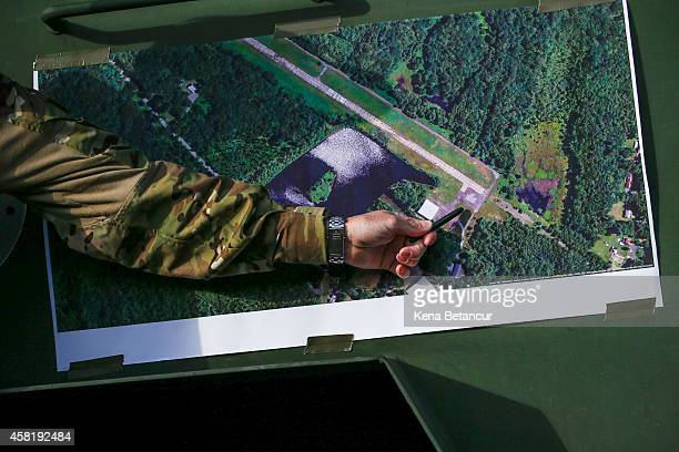 Scott Malkowski Task Force Commander US Marshals Service Special Operations Group show the map of the operation in which they captured Eric Matthew...