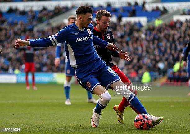 Scott Malone of Cardiff holds off pressure from Chris Gunter of Reading during the FA Cup Fourth Round match between Cardiff City and Reading at...