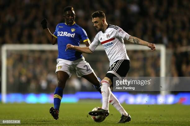 Scott Malone of Fulham and Hadi Sacko of Leeds United in action during the Sky Bet Championship match between Fulham and Leeds United at Craven...