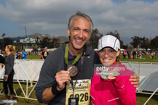 Scott Mantz and Kit Hoover attend the Rock n' Roll Marathon Pasadena at the Rose Bowl on February 19 2012 in Pasadena California
