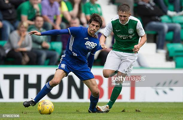 Scott Martin of Hibernian challenges Diego Fabrini of Birmingham City during the PreSeason Friendly between Hibernian and Birmingham City at Easter...
