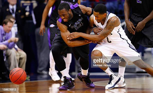 Scott Martin of the Notre Dame Fighting Irish and Eric Atkins of the Notre Dame Fighting Irish battle for a loose ball at Purcel Pavilion on December...