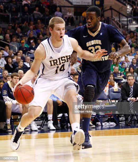 Scott Martin of the Notre Dame Fighting Irish dribbles past Isaiah Armwood of the George Washington Colonials at Purcel Pavilion on November 21 2012...