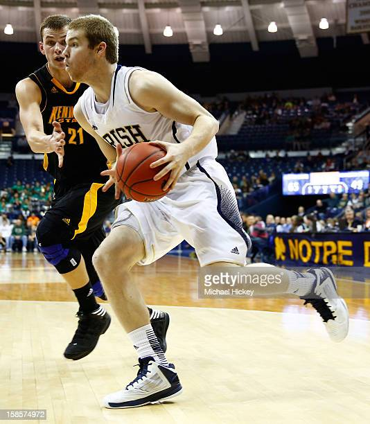Scott Martin of the Notre Dame Fighting Irish dribbles the ball along the baseline as Aaron Anderson of the Kennesaw State Owls defends at Purcel...