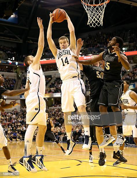 Scott Martin of the Notre Dame Fighting Irish grabs a rebound during the game against the Purdue Boilermakers during Boston Scientific Close The Gap...