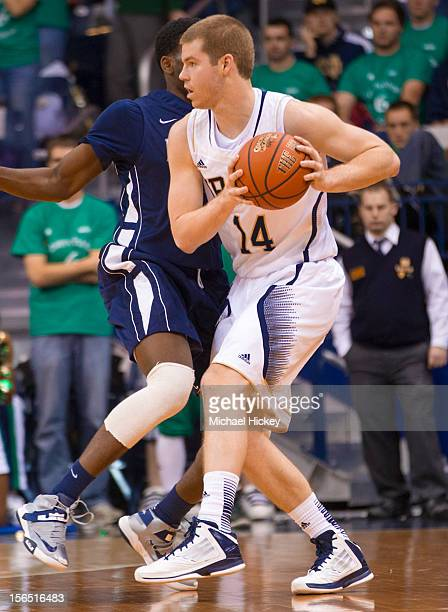 Scott Martin of the Notre Dame Fighting Irish holds the ball in the backcourt during the game against the Monmouth Hawks at Purcel Pavilion on...