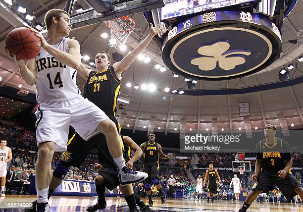 Scott Martin of the Notre Dame Fighting Irish tries to keep the ball inbounds as Aaron Anderson of the Kennesaw State Owls defends at Purcel Pavilion...