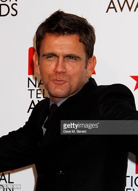 Scott Maslen poses in front of the winners boards at the National Television Awards at O2 Arena on January 26 2011 in London England