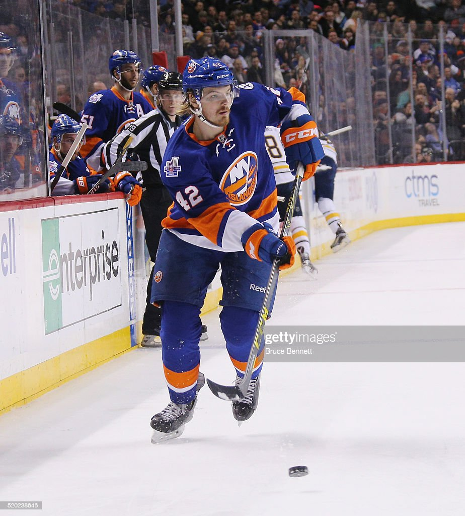 Scott Mayfield #42 of the New York Islanders skates against the Buffalo Sabres at the Barclays Center on April 9, 2016 in the Brooklyn borough of New York City. The Sabres defeated the Islanders 4-3 in overtime.