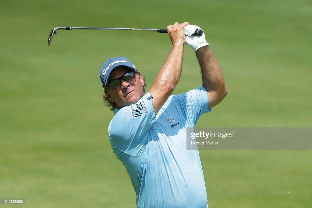 <a gi-track='captionPersonalityLinkClicked' href=/galleries/search?phrase=Scott+McCarron&family=editorial&specificpeople=221418 ng-click='$event.stopPropagation()'>Scott McCarron</a> hits his second shot on the 18th hole during the first round of the Champions Tour American Family Insurance Championship at University Ridge Golf Course on June 24, 2016 in Madison, Wisconsin.