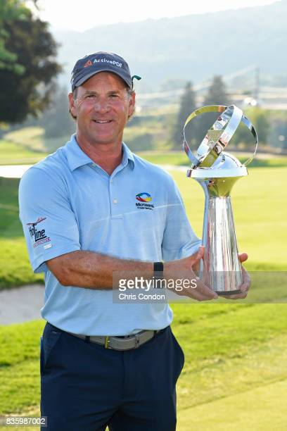 Scott McCarron poses with the tournament trophy after winning the PGA TOUR Champions DICK'S Sporting Goods Open at EnJoie Golf Course on August 20...