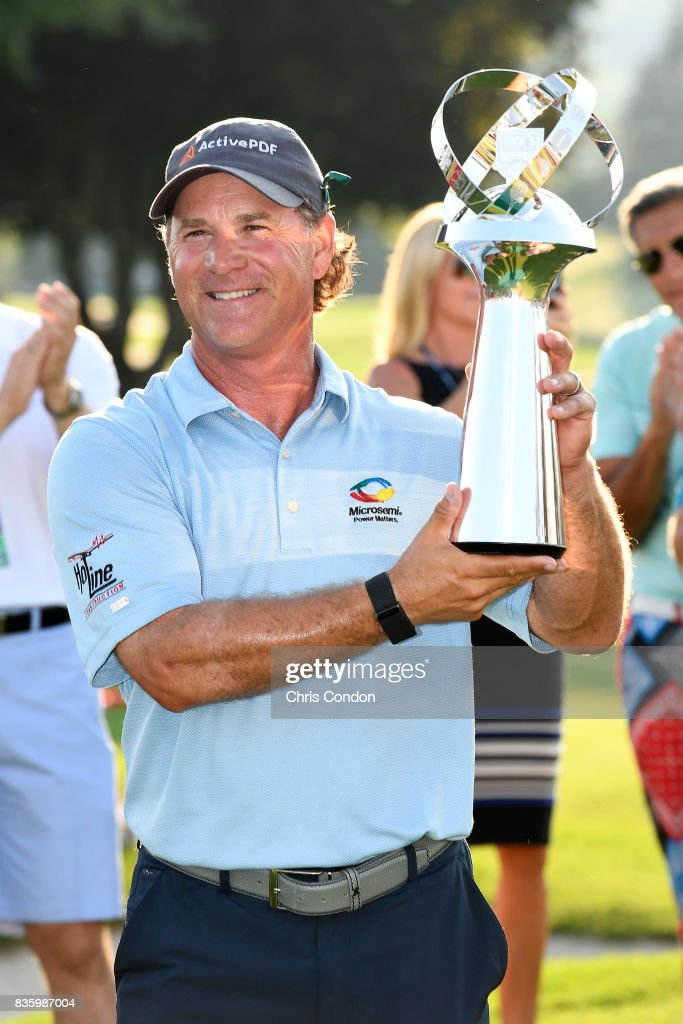 Scott McCarron poses with the tournament trophy after winning the PGA TOUR Champions DICK'S Sporting Goods Open at En-Joie Golf Course on August 20, 2017 in Endicott, New York.