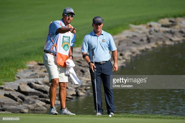 Scott McCarron putts on the 15th hole during the final round of the PGA TOUR Champions DICK'S Sporting Goods Open at EnJoie Golf Course on August 20...