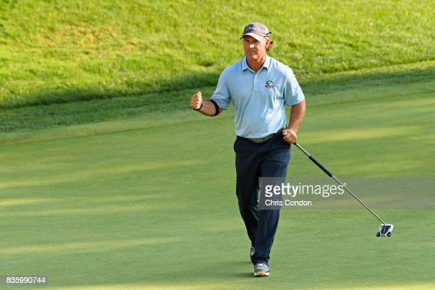 Scott McCarron reacts after making a birdie on the 17th hole during the final round of the PGA TOUR Champions DICK'S Sporting Goods Open at EnJoie...