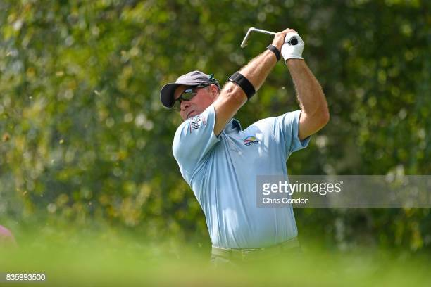 Scott McCarron tees off on the 7th hole during the final round of the PGA TOUR Champions DICK'S Sporting Goods Open at EnJoie Golf Course on August...
