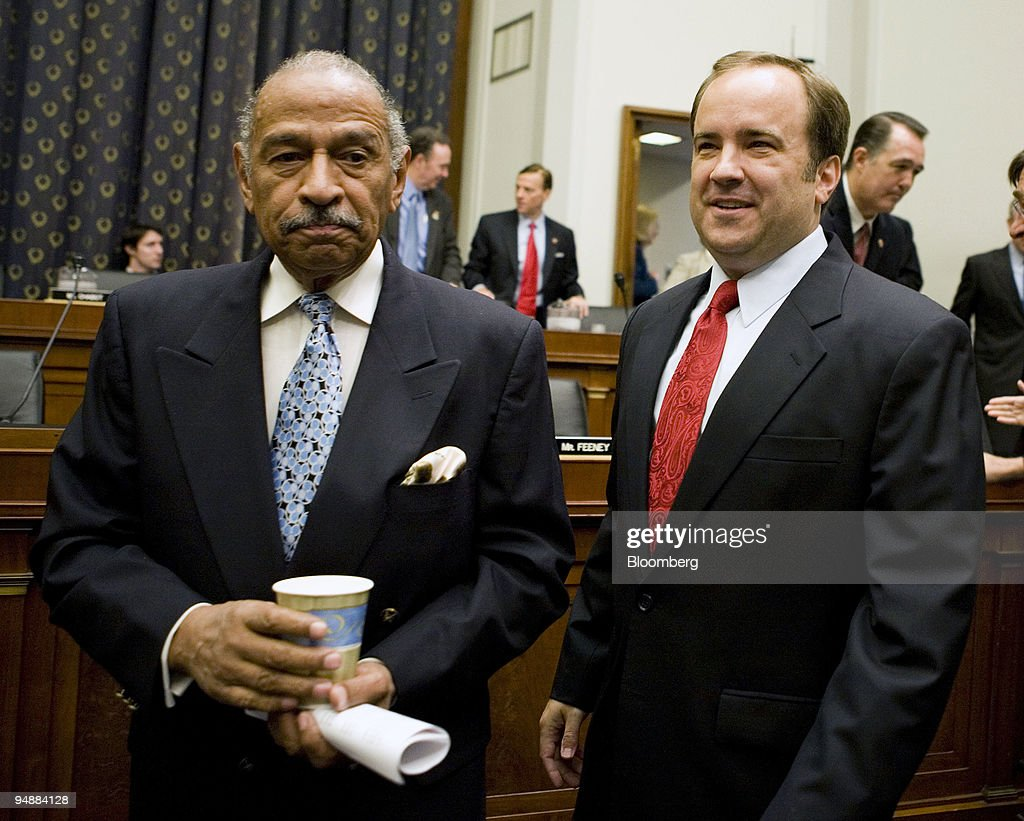 Scott McClellan, former press secretary for U.S. President George W. Bush, right, walks with John Conyers, U.S. Representative from Michigan and chairman of the House Judiciary Committee, before a hearing in Washington, D.C., U.S., on Friday, June 20, 2008. McClellan told lawmakers he doesn't know whether Vice President Dick Cheney or other government officials committed a crime in connection with the leak of a CIA operative's identity.